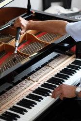 Настройка пианино,  ремонт.