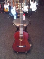 Продам гитарный комплект-гитара,  челох, ремень, струны и тюнер!